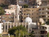 Syrian town with mosque and church — Stock Photo