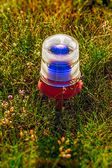 Ground side lamp taxiway at the airport — Stock Photo