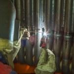 Welder welding metal pipes — Stock Photo #43975993
