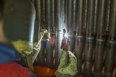 Welder welding metal pipes — Stock Photo
