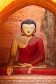 Old renovated sculpture of a seated Buddha — Stock Photo