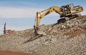Excavator and drill machine. — Stock Photo