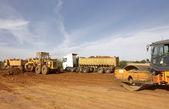 Tractors and dump trucks — Stock Photo