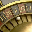 Постер, плакат: Playing on a vintage roulette