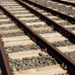 Stock Photo: Rails sleepers and stones background.