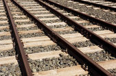Rails sleepers and stones background. — Stock Photo