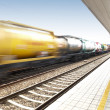 Freight train on railway station — Stock Photo