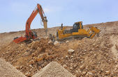 Excavator machines loading soil — Stock Photo