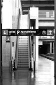 Railway station with signposting and escalators — Stock Photo