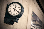 Outdoor analog clock in a railway station — Stock Photo