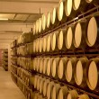 Wine barrels in aging cellar — Stock Photo #26371363
