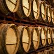 Wine barrels in an aging process — Stock Photo