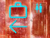 Baggage claim and rest rooms signs — Stock Photo