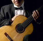 Classical Guitarist with Smoking Jacket — Stock Photo