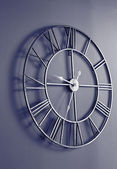 Wall clock with roman numbers — Stock Photo