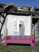 Sofa in abandoned rural place — Stock Photo