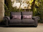Sofa in a beautiful patio — Stock Photo