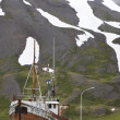 Old fishing boat and mountain. Iceland. Siglufjordur. — Stock Photo