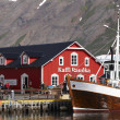Stock Photo: Restaurants and fishing boat in harbor.