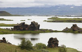Lake, lava formations and mountains in Myvatn Iceland — Stock Photo