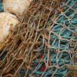Fishing nets with buoys close up. — Stock Photo