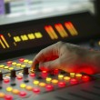 Male hand on control Film Mixing console — Stock Photo