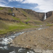 Stock Photo: Waterfall and river in Hengifoss valley, Iceland East fjords.