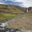 Waterfall and river in Hengifoss valley, Iceland East fjords. — Stock Photo #35907117