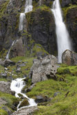 Waterfall and basaltic rocks. Iceland. Seydisfjordur. — Stock Photo