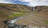 Waterfall and river in Hengifoss valley, Iceland East fjords. — Stock Photo