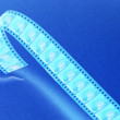 Stock Photo: Negative film reel blue toned