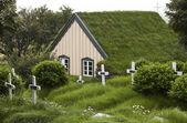 Iceland. Southeast area. Hof. Cemetery and church with peat roof — Stock Photo