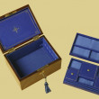 Old jewelry box with compartments on blue velvet — Stock Photo