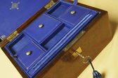 Old jewelry box with compartments on blue velvet — Fotografia Stock