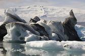 Iceland. Southeast area. Jokulsarlon. Icebergs, lake and glacier — ストック写真