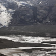 Stock Photo: Iceland. South area. Eyjafjalajokul glaciar tongue, river and 4w