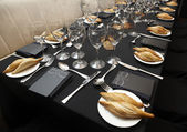 Tableware and cutlery on a table. — Stock Photo