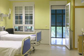 Hospital room with beds and furniture. — Stock Photo