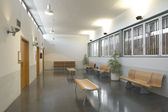 Hospital corridor with private medical offices. — Stock Photo