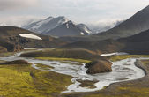 Iceland. South area. Fjallabak. Volcanic landscape with river. — Stockfoto