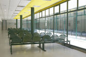 Waiting area with green chairs and windows. — Stock Photo