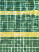 Water reflection on a green and yellow surface. — Stock Photo