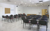 Classroom interior with projector, screen and chairs — Stock Photo