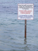 Signal post on the water. Prohibited to swim — Stock Photo