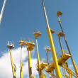 Yellow telescopic cranes with a blue sky background — Stock Photo #46080533