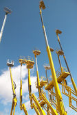 Yellow telescopic cranes with a blue sky background — Stock Photo