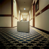 Modern briefcase in an hotel corridor — Foto Stock