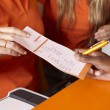Bet tickets detail with hands and pen — Stock Photo