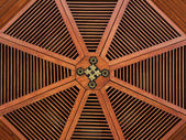 Red wooden structure in a roof with golden parts — Stock Photo