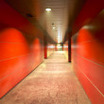 Modern building red corridor with metallic walls — Stock Photo
